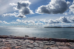 Seaside landscape with cloudy sky Royalty Free Stock Images