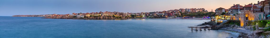 Seaside landscape, panorama, banner - view of the embankment with fortress wall during sunset in the city of Sozopol Stock Photos