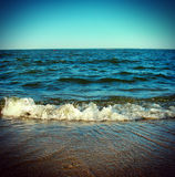 Seaside Landscape. Vintage photo of seaside landscape with coming waves Stock Photography