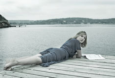 Seaside life. Life by the sea, portrait of a relaxing woman on an overcast day Stock Images