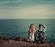Seaside. Looking the far sea couple sitting on adventure coast royalty free stock photography