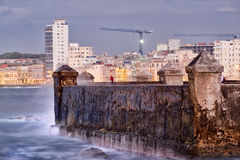 The seaside Malecon wall in Havana at sunset. With a view of the ocean and the city skyline Royalty Free Stock Image