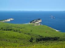 Seaside meadow coast landscape. Sea landscape with flowers  meadow and blue sky Stock Photos