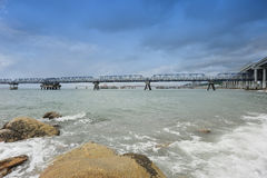 Seaside oil pipelines and bridge Royalty Free Stock Image