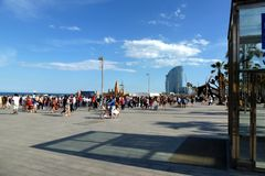 Seaside panoramic view of Barcelona beach under blue sky royalty free stock photos