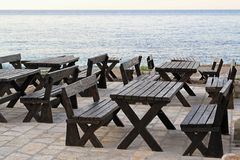 Seaside picnic tables Stock Image