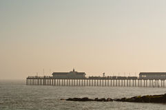 Seaside Pier. Holiday makers enjoying a quiet day in hazy sunshine on a seaside pier Royalty Free Stock Photos