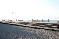 Seaside pier on Italian coast in morning light royalty free stock photos