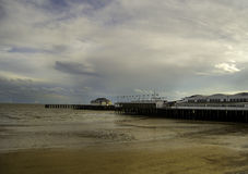 Seaside with a pier. Sandy seaside in south England with a pier Stock Photos