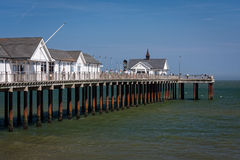 Seaside Pier in Southwold, England. Holidaymakers on the pier in the seaside resort of Southwold, Suffolk, England Stock Images