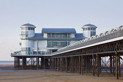 Seaside Pier in Winter. The restored pier at Weston-super-Mare UK with a deserted beach in midwinter Stock Photo