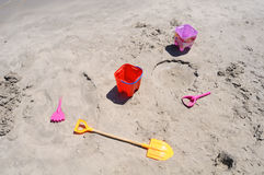 Seaside Playthings. A few seaside items left on a beach Royalty Free Stock Photo