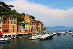 Seaside Portofino. View of marina with yachts, boats and colours residential buildings , above blue sky and white clouds. 9 august 2015 Royalty Free Stock Photography