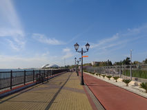 Seaside promenade with lanterns and bicycle path, Sochi, Russia. Seaside promenade with lanterns and bicycle path at sunny day Stock Image