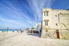 Seaside promenade with many tourists in Otranto, Italy. Seaside promenade by historic architecture in Otranto, Apulia, Italy Stock Photo