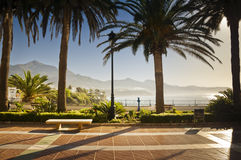 Seaside promenade in Nerja, Spain. Empty promenade along Mediteranean Sea at sunrise in a little town in Andalusia, Spain, called Nerja royalty free stock photography