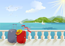 Seaside promenade and suitcases Stock Photography