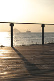 Seaside promenade. In the Sunset and a ship on the sea feel relax Stock Photo