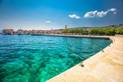 Seaside promenade in Supetar town on Brac island with palm trees and turquoise clear ocean water, Supetar, Brac, Croatia, Europe.  royalty free stock photos