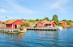 Seaside red cottages Royalty Free Stock Photos