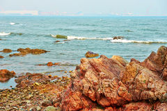 The seaside red megalith Stock Photos