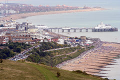 Seaside resort. Eastbourne beach Busy seafront in Sussex England Seaside resort for holiday makers in England Famous pier landmark Royalty Free Stock Photo