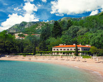 Seaside resort at Montenegro. Resort on the sea beach, mountains and forests around. Montenegro Stock Photos