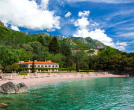 Seaside resort at Montenegro. Resort on the sea beach, mountains and forests around. Montenegro Stock Image
