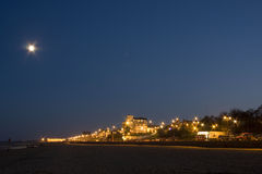 Seaside resort under moonlight Stock Photography