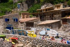 Seaside restaurant in Mallorca, Spain. Mallorca, Spain - June 28, 2017: Ca`s Patro March restaurant in Cala Deia Beach provides guests with a wide selection of Royalty Free Stock Photos