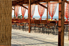 Seaside restaurant tables and chairs Royalty Free Stock Photos