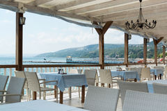 Seaside Restaurant Tables And Chairs Royalty Free Stock Image