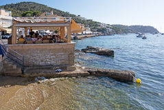 Seaside restaurants Port Andratx Mallorca. PORT ANDRATX, MALLORCA, SPAIN - AUGUST 5, 2016: Seaside restaurants in the harbor on a sunny summer day in August 5 in Royalty Free Stock Photos