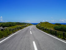 Seaside road in Yonaguni Island, Japan. Seaside road in Yonaguni Island, western border island of Japan. It's a part of Okinawa Stock Image