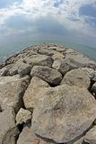 Seaside rocks and breakwaters photographed with the fisheye lens Royalty Free Stock Photography