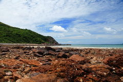 Seaside Rocks. Seaside with a rock foreground and background of blue sky Royalty Free Stock Photo