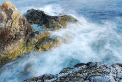 Seaside rocks and waves Royalty Free Stock Images