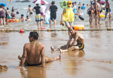 Seaside sand bath of people Royalty Free Stock Images