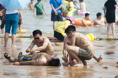 Seaside sand bath of people Stock Photo