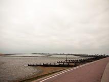 Seaside scene overcast mudflats walkpath trail gryones. England; UK Stock Images