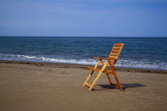 Seaside scenic view with beach chair. Brightly lit with the sun Royalty Free Stock Image