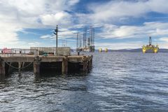 Cromarty Harbour and oil rigs stock photography