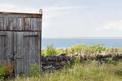 A seaside shed. A wooden shed on the Welsh coast stock images