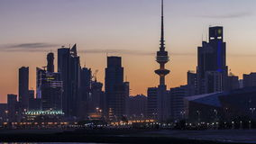 Seaside skyline of Kuwait city from night to day timelapse. Seaside skyline of Kuwait city from night to day transition timelapse. Modern illuminated towers and stock footage