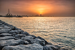 Seaside skyline of Kuwait city Stock Photos