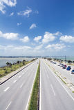 Seaside straight roadway Stock Image