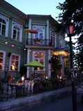 Seaside style restaurant. Tallinn fairylights umbrella hipster restaurant Royalty Free Stock Photography