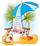 Beach Chair, Umbrella and Sunglasses Royalty Free Stock Images