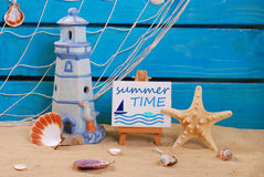 Seaside summer holidays still life with text written on easel Stock Images