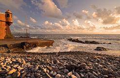 Seaside at sunset. Pebble beach at the Atlantic ocean at sunset stock image